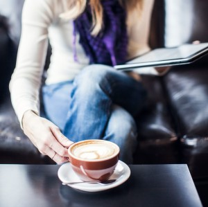 woman with coffee and tablet